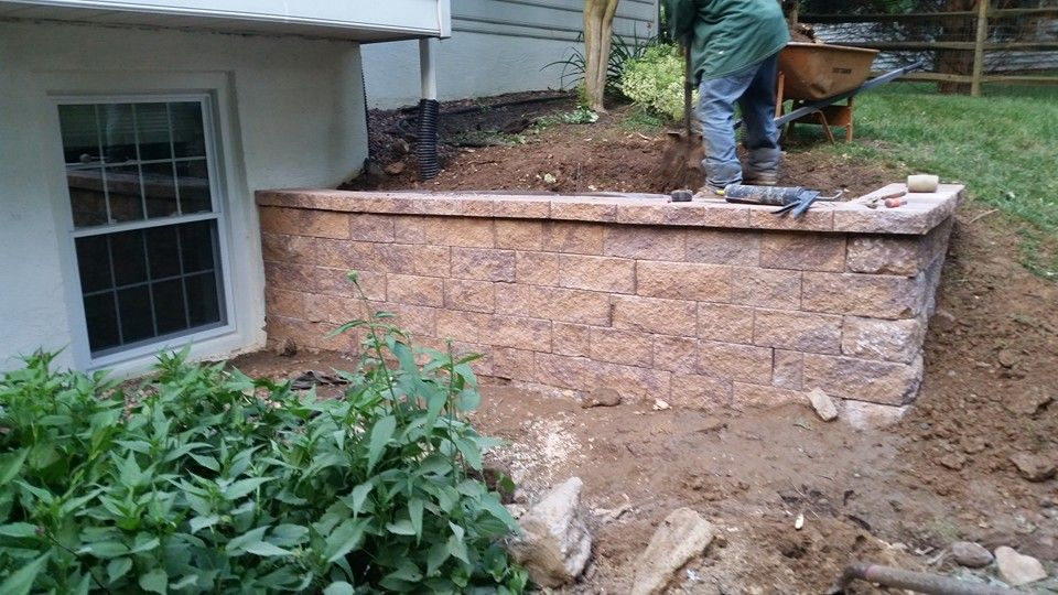 front retaining wall due to erosion issues