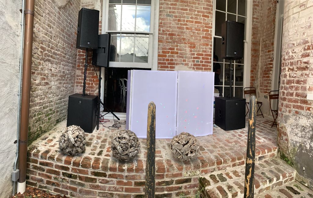 Audio Equipment Rental with DJ Booth and Lighting