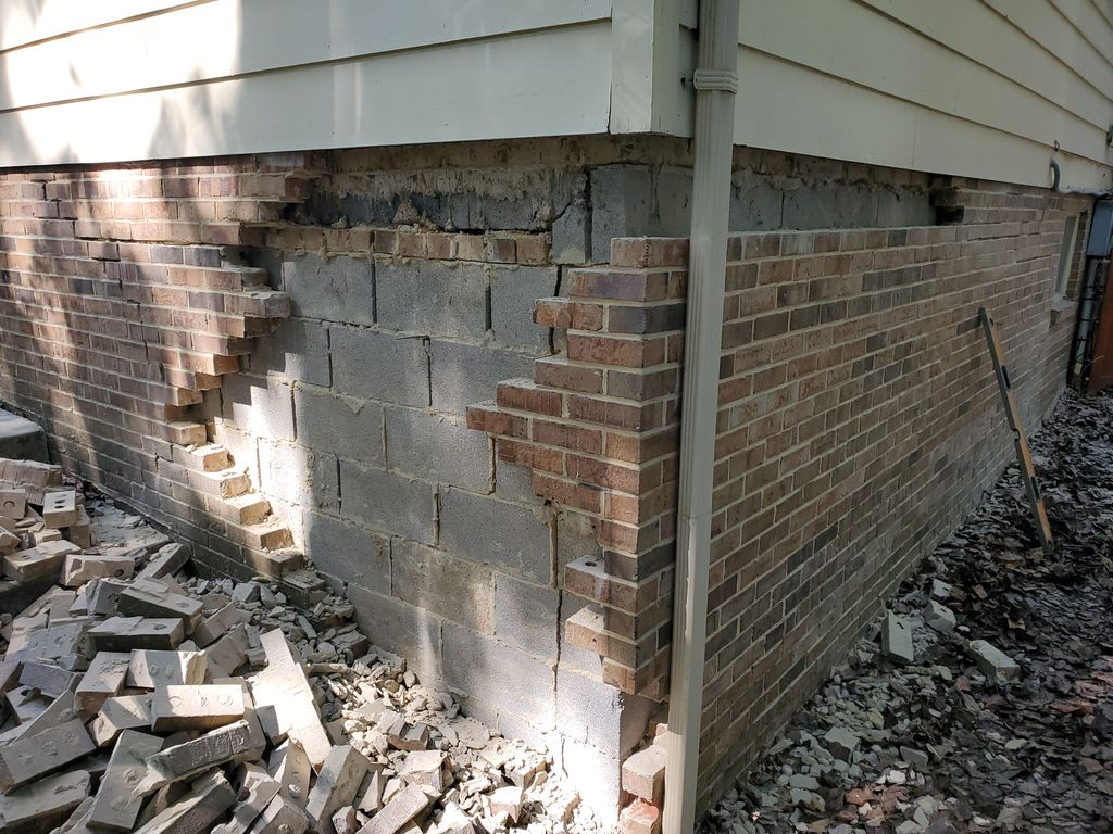 Repair of brick wall  Before and after photo