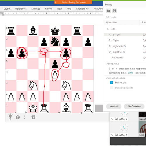 Students annotate their moves on the chess board