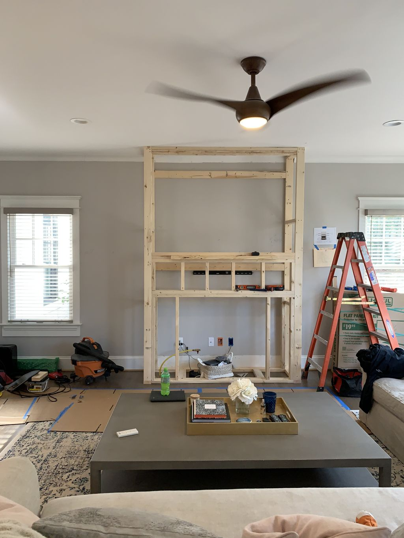 Shiplap and brick fireplace build