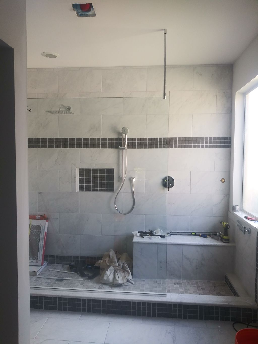 Expand shower with frameless glass