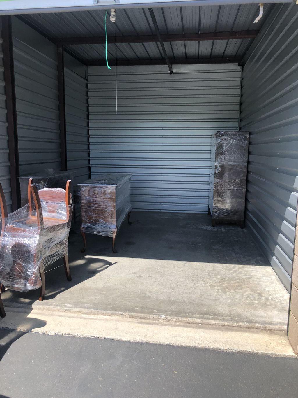 Moving furniture from the garage   In to the truck to the storage