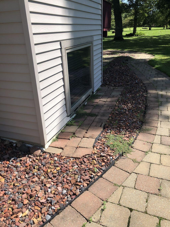 Re-laying brick for sidewalk