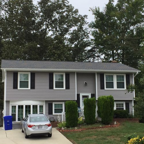 New vinyl siding, trim, gutters and shutters