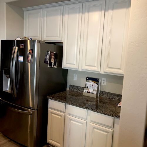 Cabinets were dark espresso, I painted them white for my client.  I do all my own work