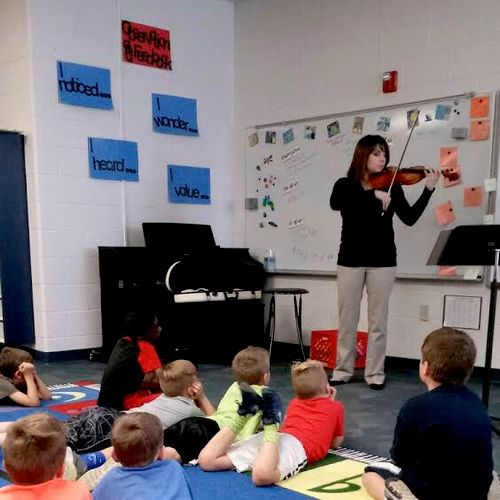 Here I am giving a demonstration on the string family at a local elementary school.
