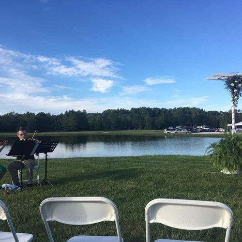 My colleague David Riley and I playing violin and viola duets for a wedding ceremony.
