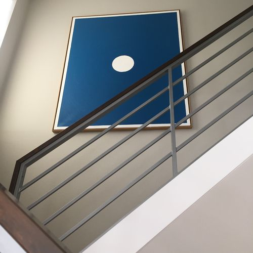 Hanging precious art in hard to reach places is one of our specialties