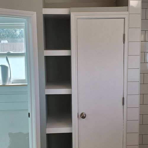 Turned this space into a usable water heater storage and shelving unit! (after)
