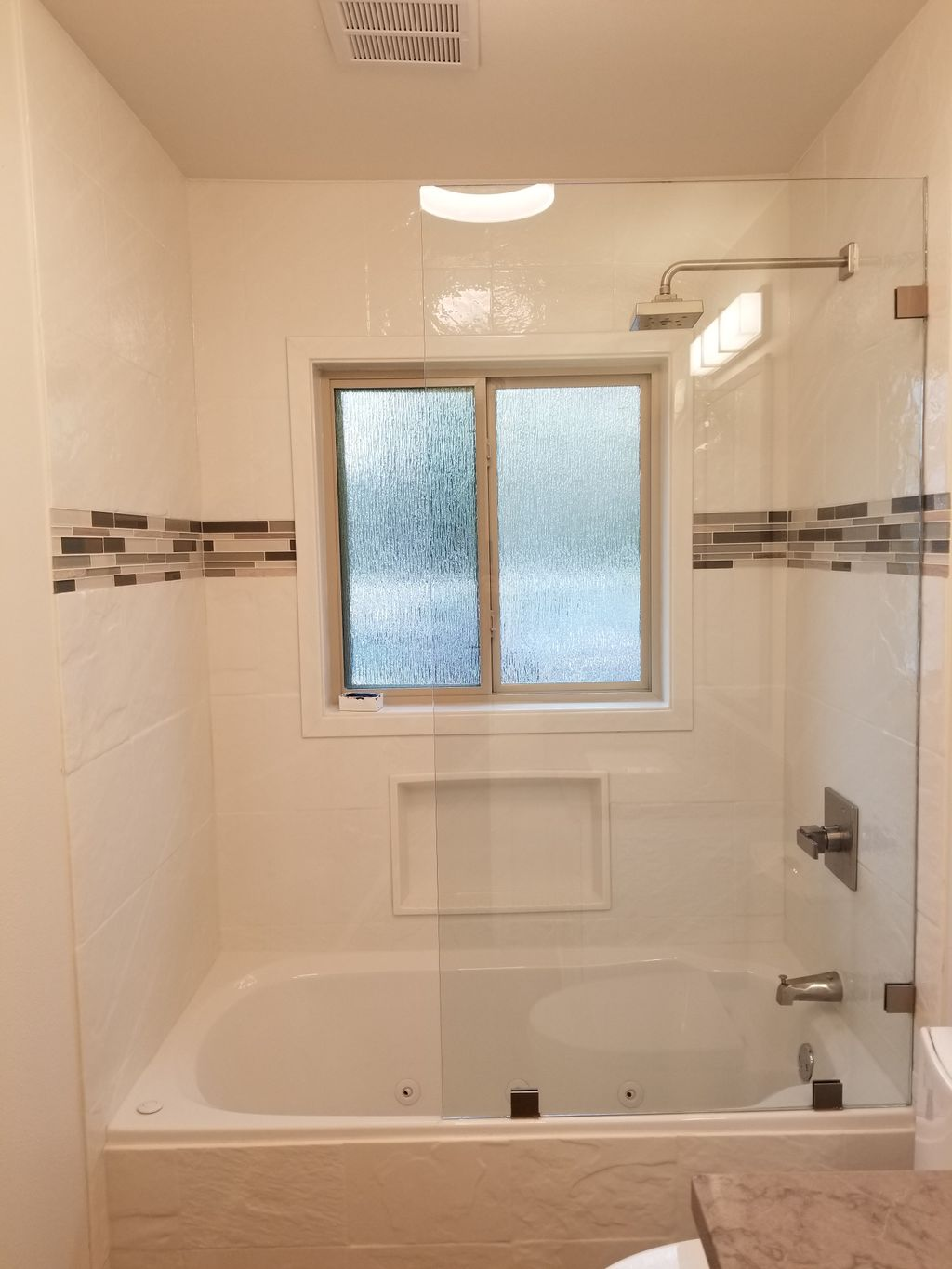 Guest bath remodel with easy to clean Onyx walls