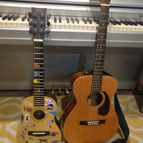 Students guitar with reward stickers next to mine!