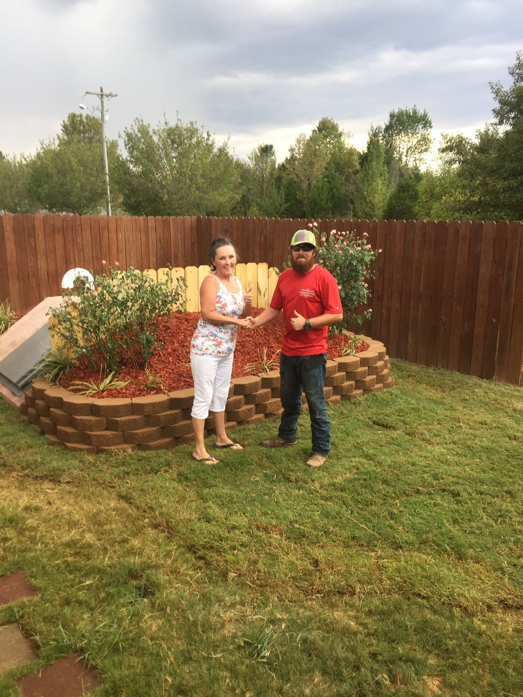 Storm shelter retaining wall