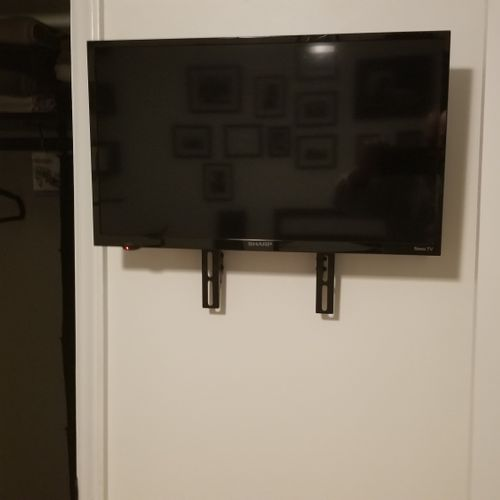 This small TV was mounted in a very small area between a bedroom door and closet door.