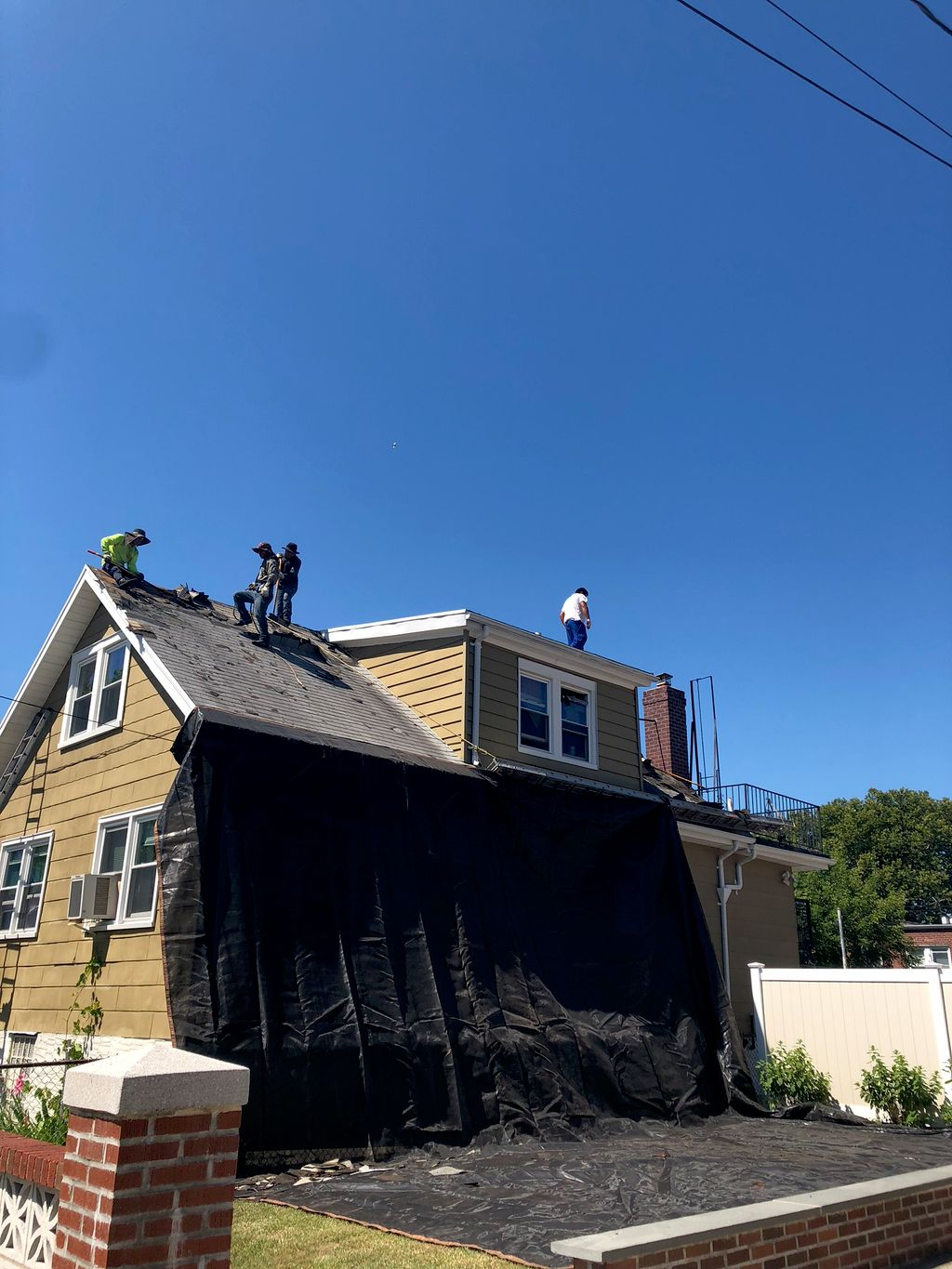 Tear off and GAF shingle installation with attached flat roof