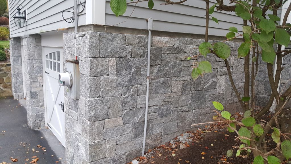Stone veneer over a foundation