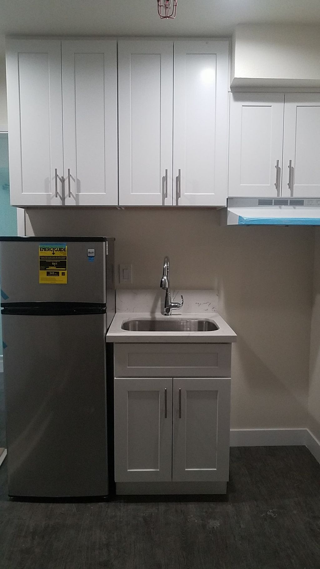convert storage and laundry room to one bedroom apartment