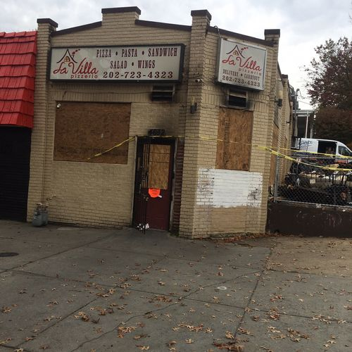 GERLYNCH OFFICERS PROTECT THE SITE OF AN ESTABLISHMENT FIRE.