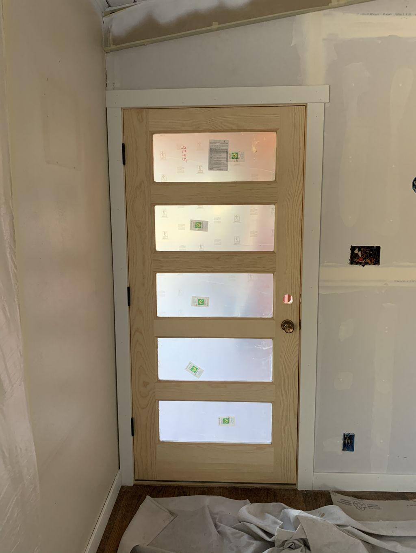 Exterior unpainted door replacement
