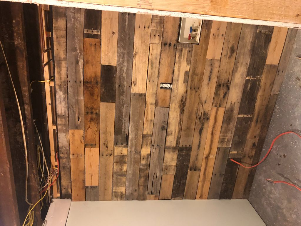 Laundry room remodel with pallet wall