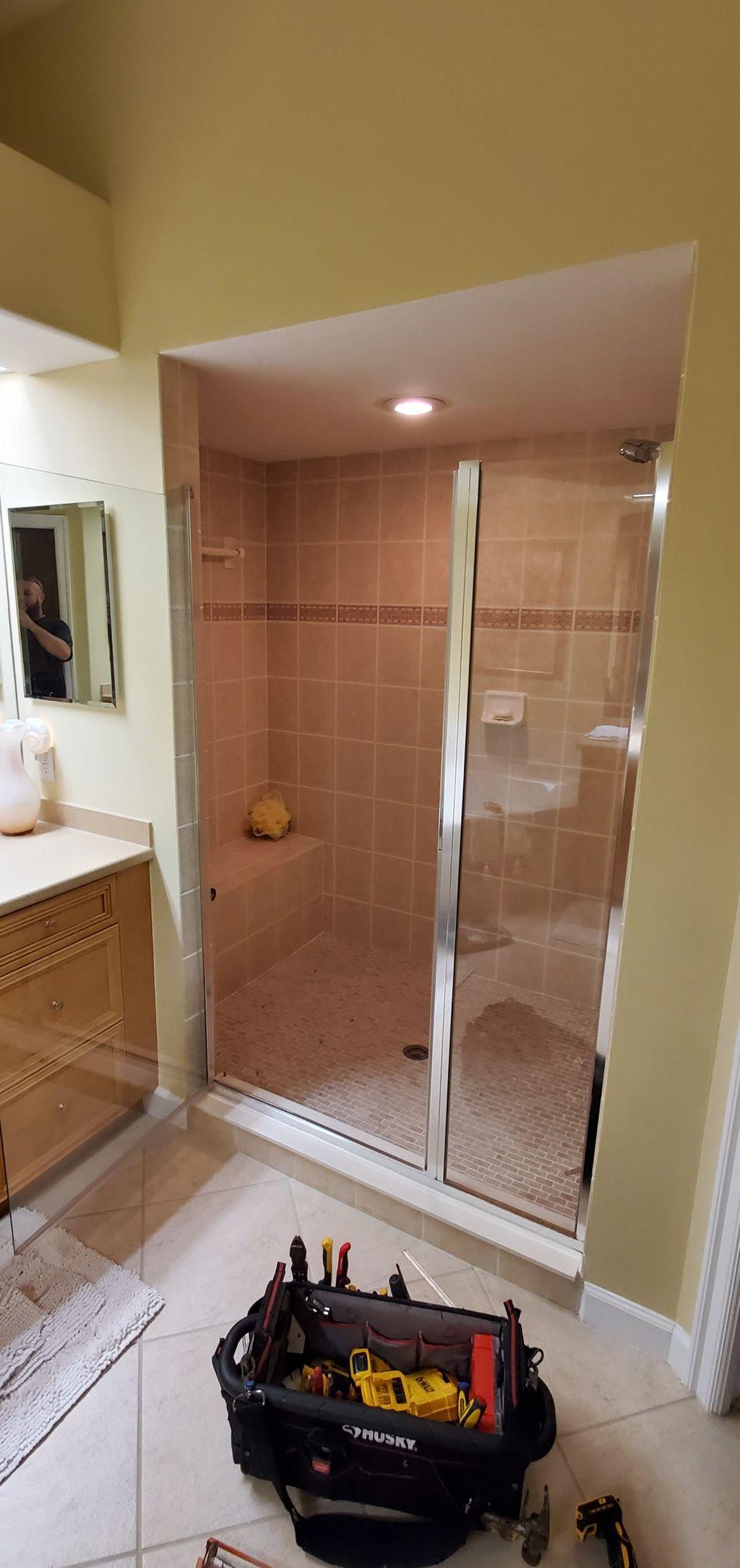 Shower sliding glass door installation