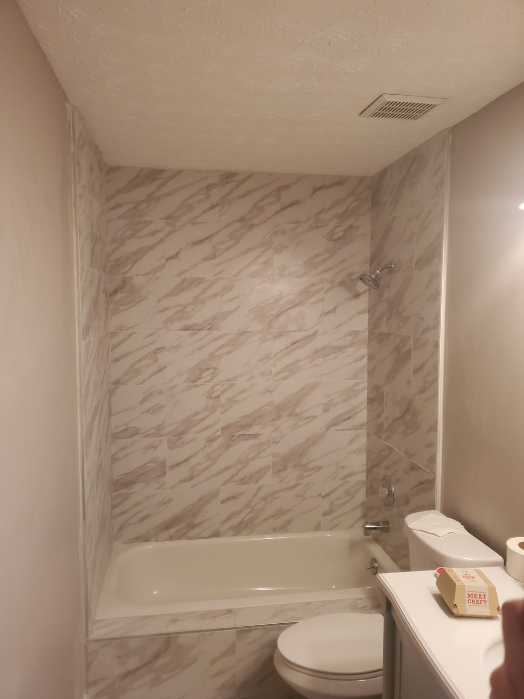Bathroom tile installation with added customize front piece