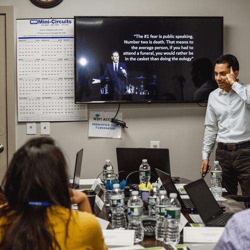 Justin Aquino conducting a team workshop on public speaking