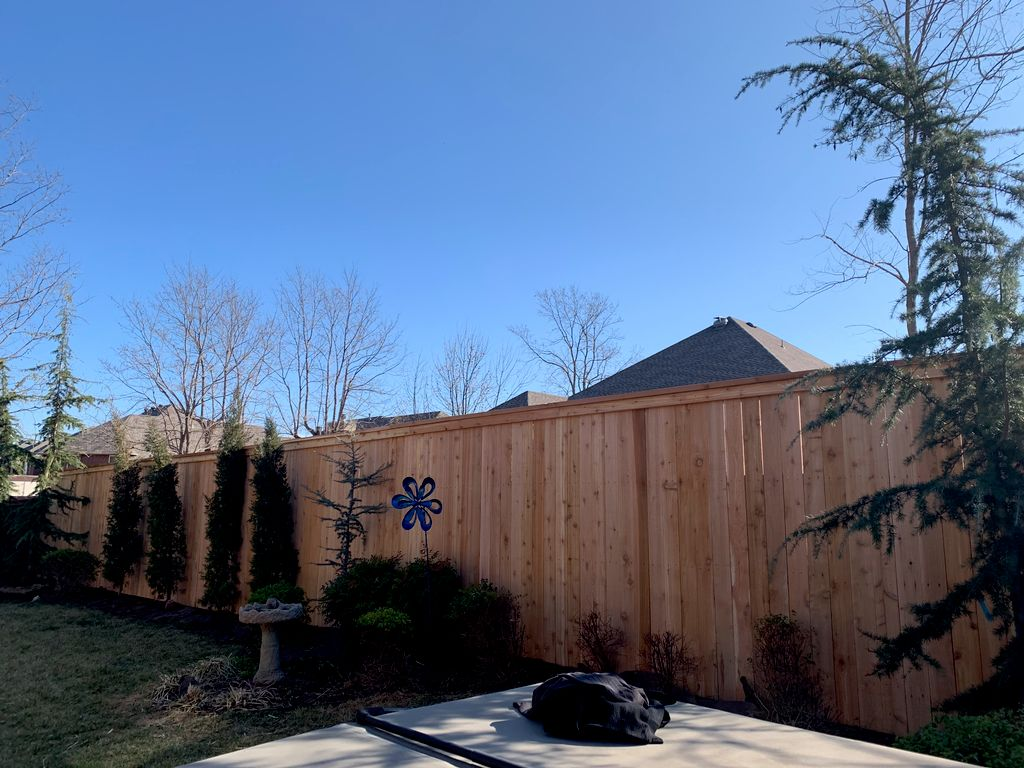 8 foot tall hand built cedar fence with cap and trim
