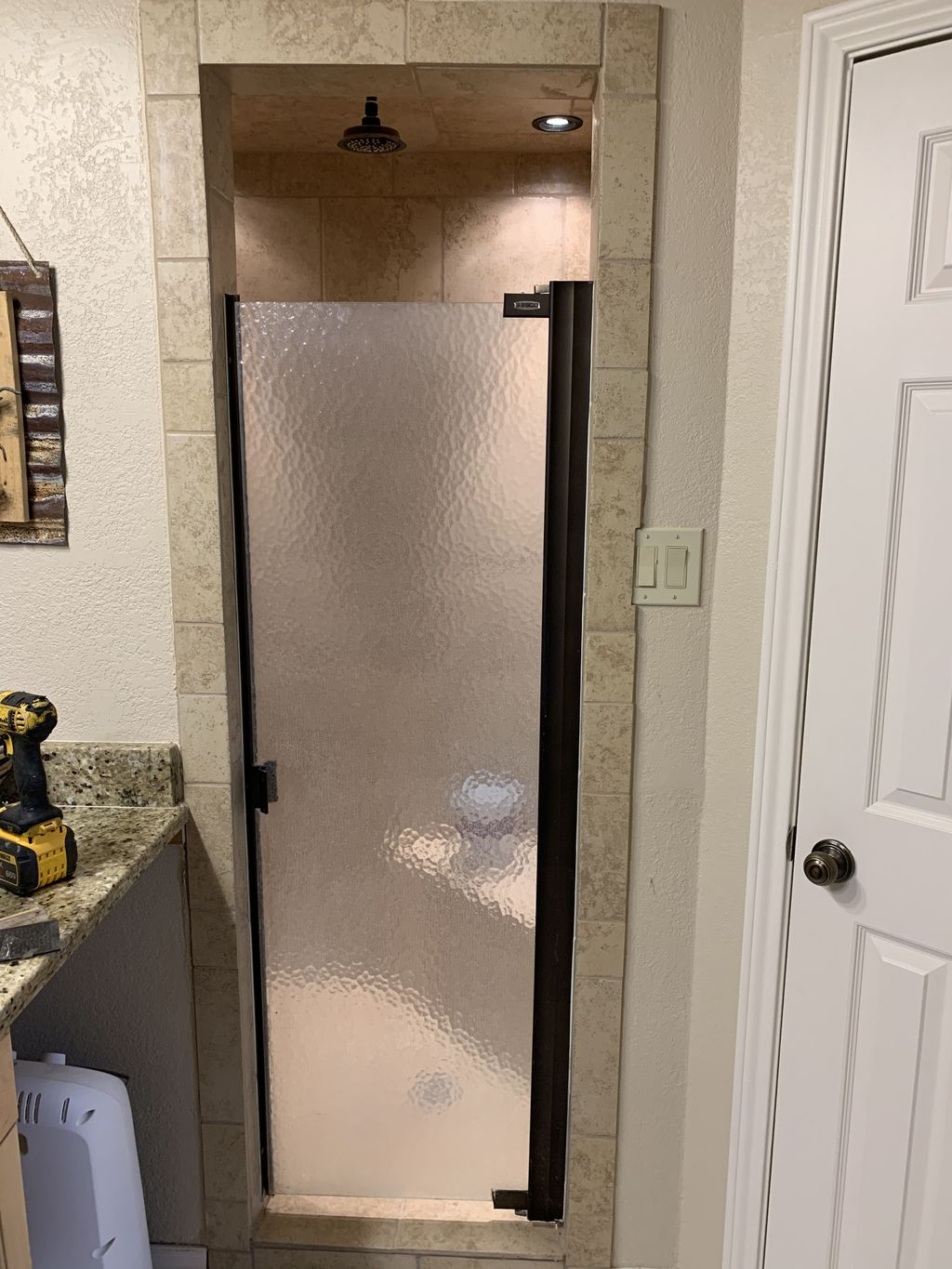 Replace shower glass door from frame to frameless