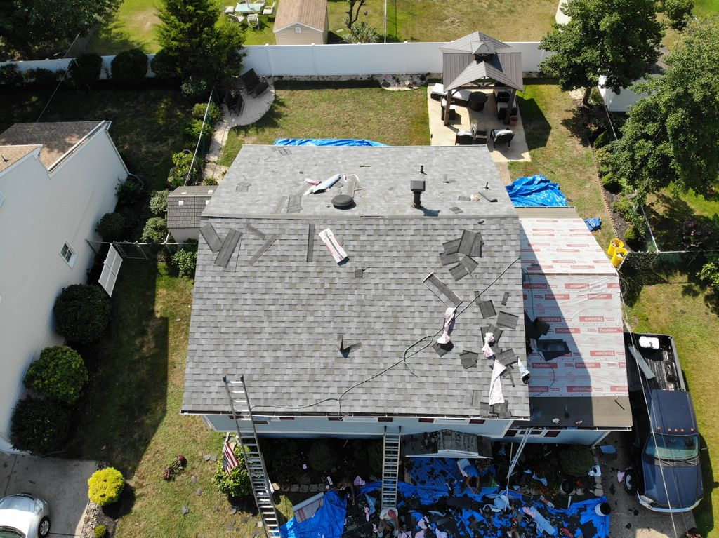 Full Roof Installation and Tear off with Gutters