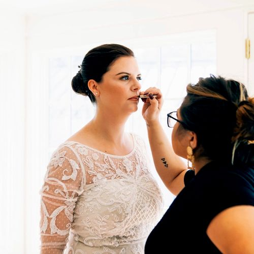 Adding the final step to this beautiful bride.. lips.