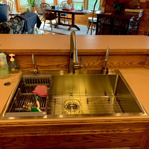 (After) Installation of • 1-single bowl stainless sink, 1-kitchen faucet w/ pull down sprayer, and 2- drinking spouts replaced