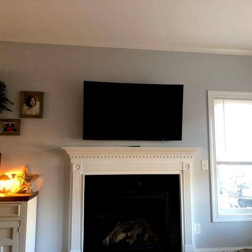 TV mounted and installed a new outlet to conceal wires