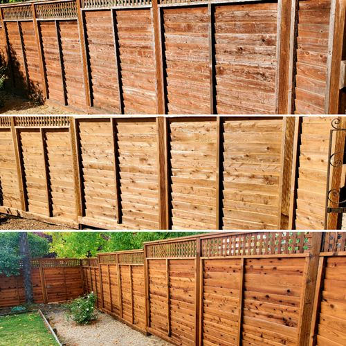 Revitalizing an old weathered fence. Used Armstrong-Clark translucent stain to highlight the woods natural beauty.
