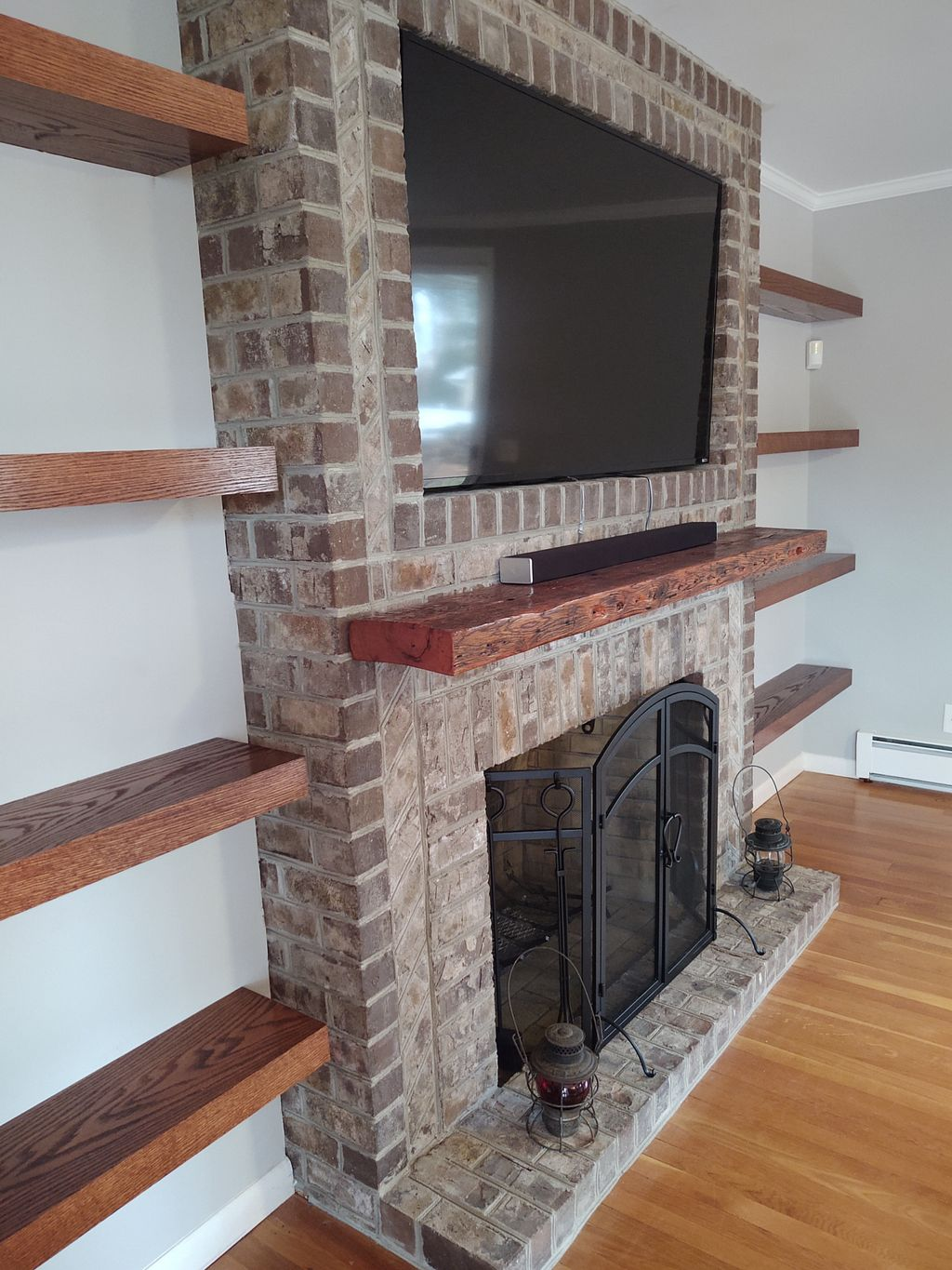 Fireplace refaced with floating shelves
