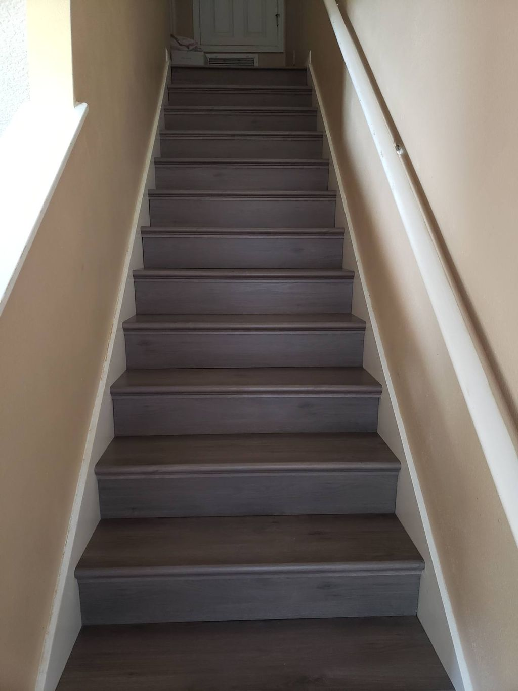 Luxury vinyl plank stairs with tread and matching risers