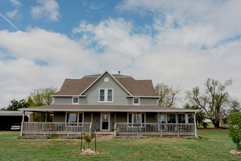 Large, Old Farmhouse Project, New siding, windows and sunroom