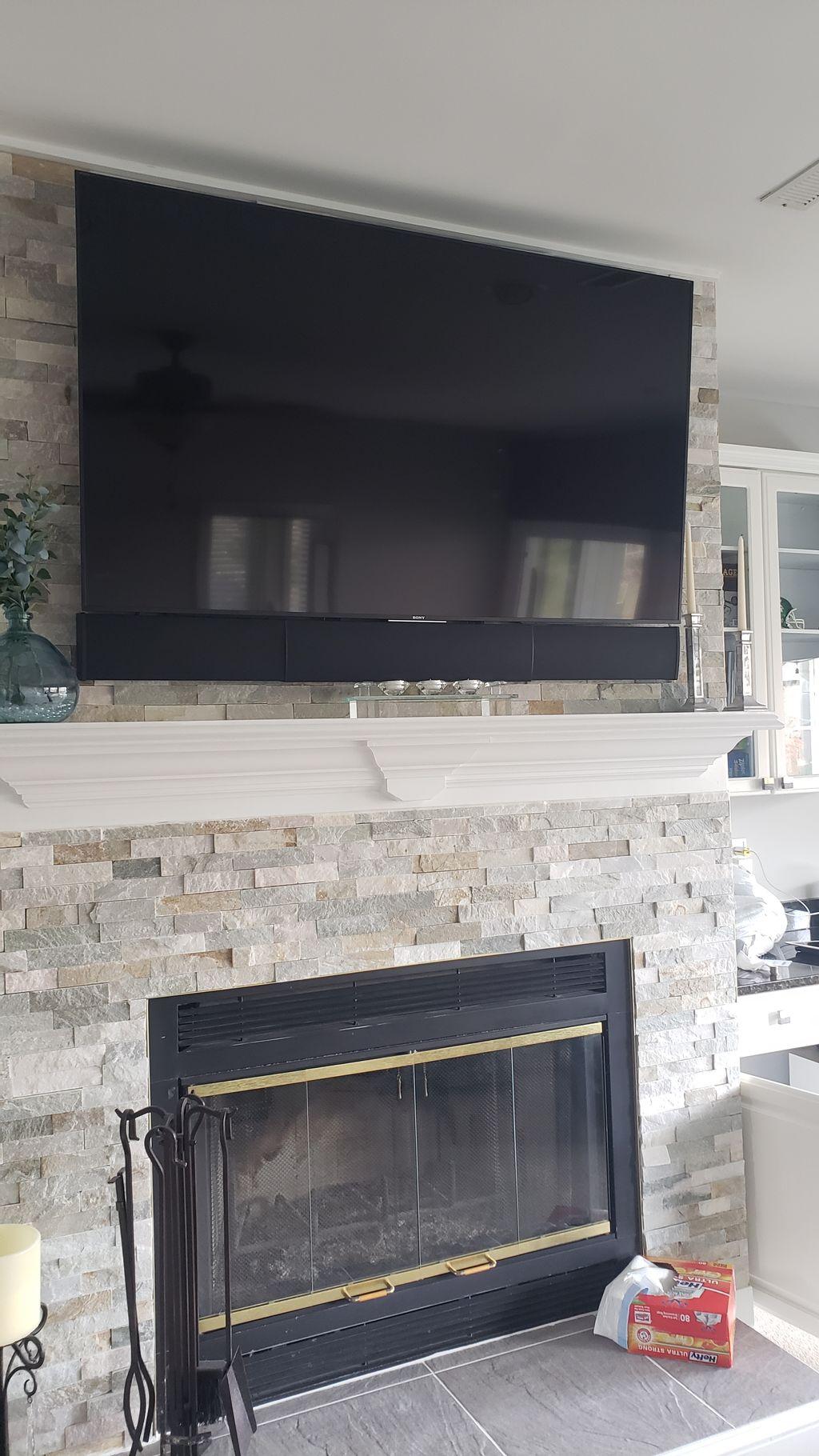 Sony TV and Adjustable Sonance Sounbar  Over custom fireplace