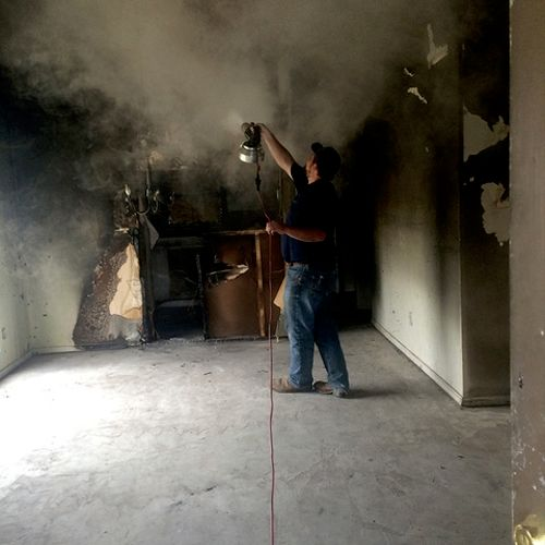 Our crews using smoke odor removal equipment, called thermal foggers, after a house fire in Dallas.