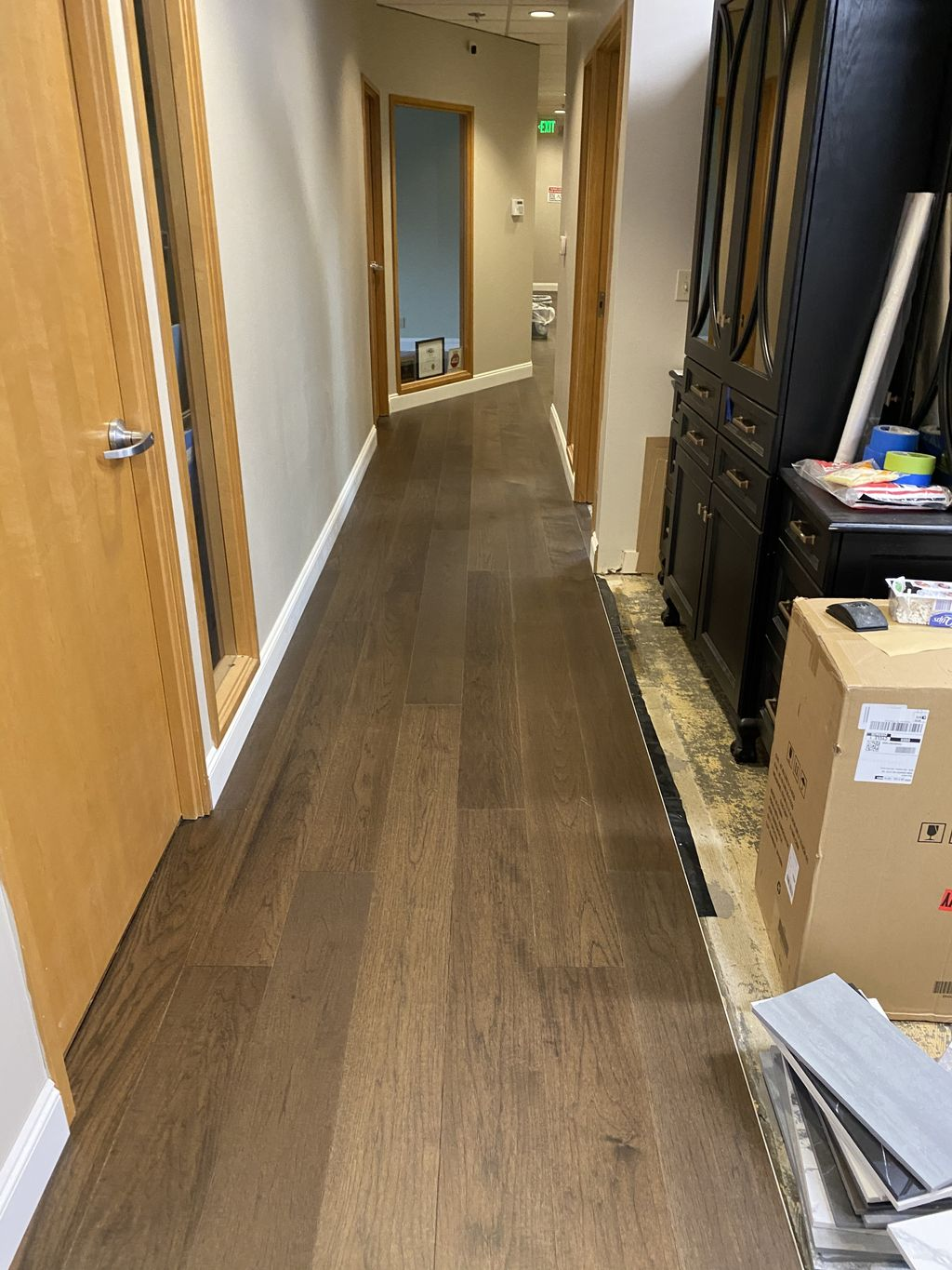 Luxury Vinyl Flooring with real engendered floors on top cover