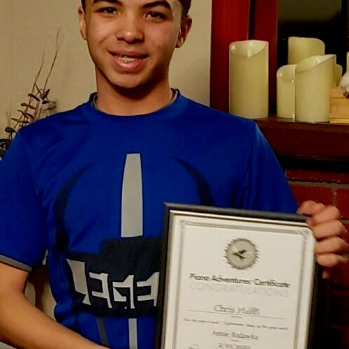 Chris received his certificate after completing the piano sight-reading book!