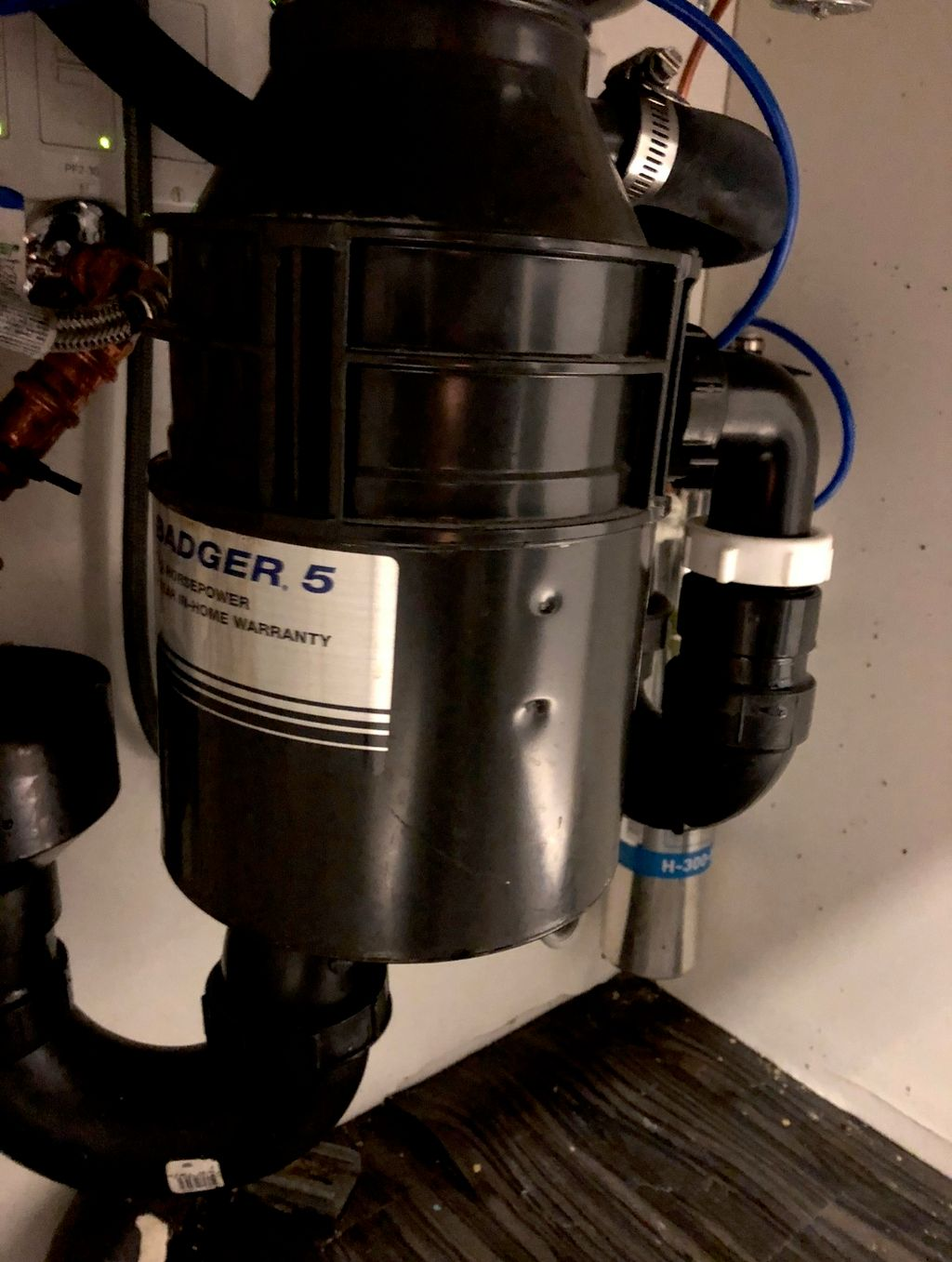 Replace garbage disposal And piping from sink