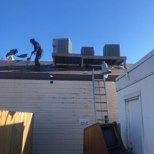 Roof top units being removed for a new roof