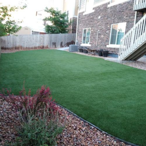 Custom shaped backyard artificial turf.