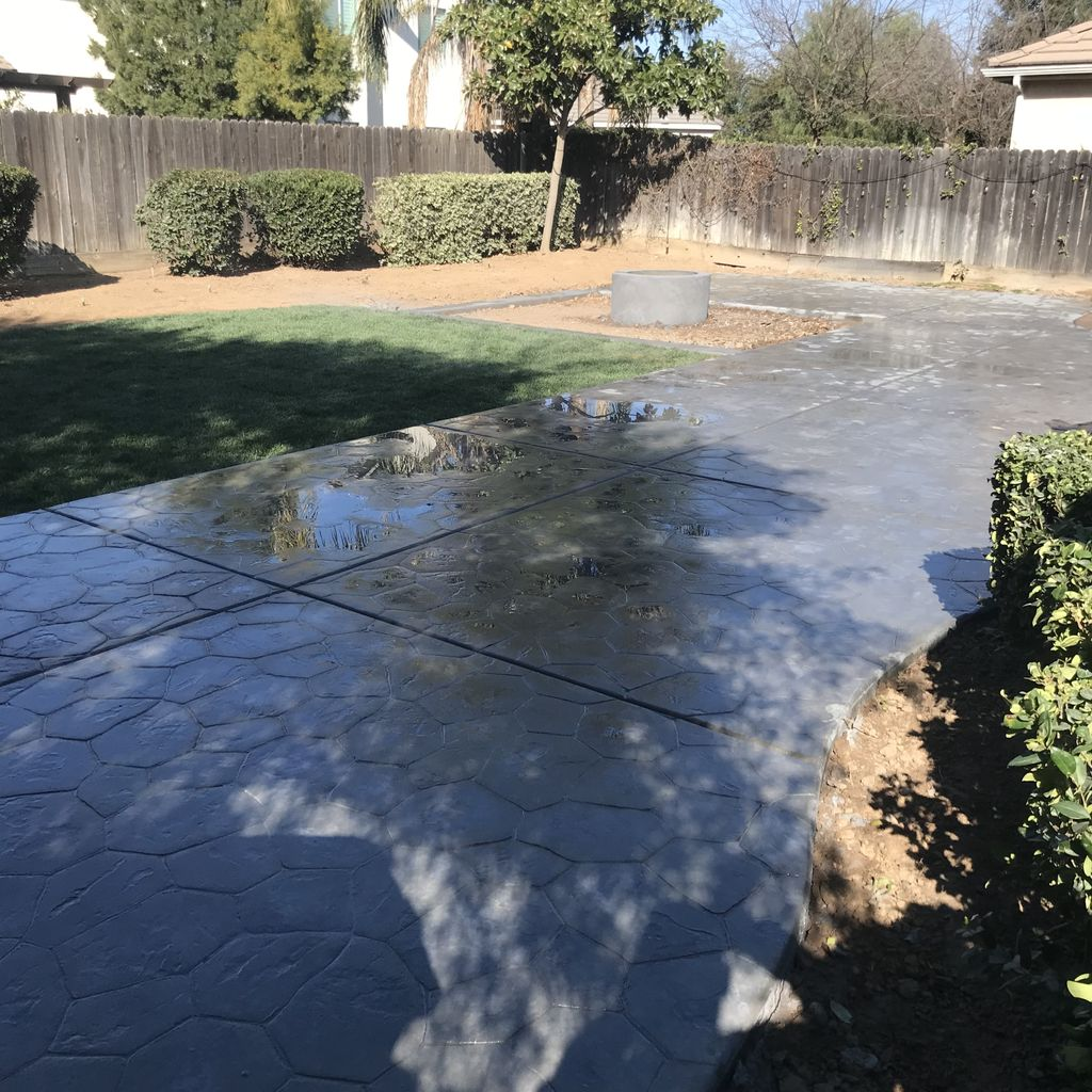 Backyard concrete, fire pit, and sod install