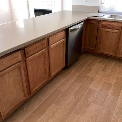 Complete kitchen renovation with new millwork, flooring and fixtures.