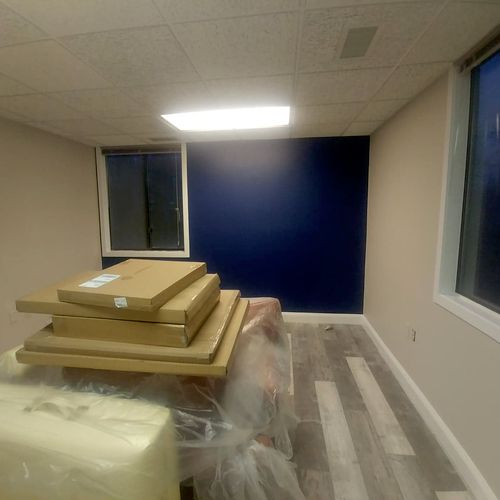 A finished office space where I did the walls beige and a blue accent finished in eggshell.