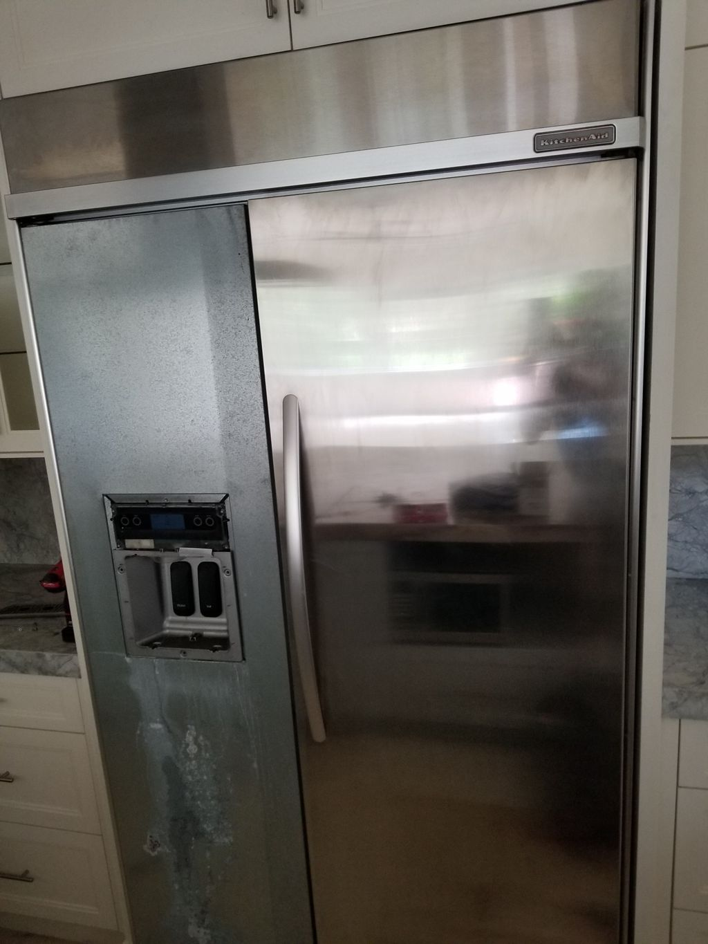 Buitl in kitchenaid fridge water and ice dispencer change out