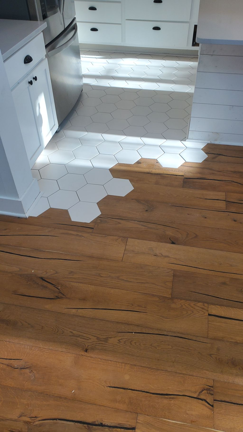 Beautiful hexagon tile cut into hardwood floor