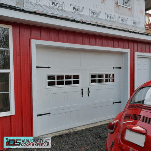 New single garage door with window inserts and straps & handles